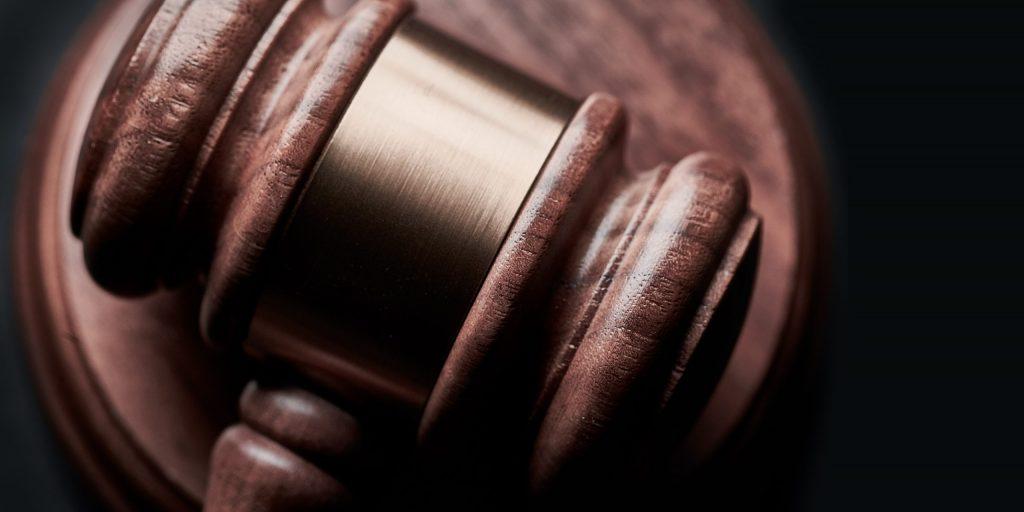 Judges gavel on wooden desk.